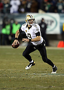 New Orleans Saints quarterback Drew Brees (9) scrambles during the NFL NFC Wild Card football game against the Philadelphia Eagles on Saturday, Jan. 4, 2014 in Philadelphia. The Saints won the game 26-24. ©Paul Anthony Spinelli