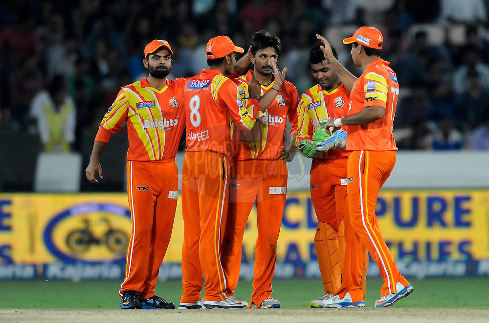 Aizaz Cheema of Lahore Lions celebrates the wicket of Manvinder Bisla of Kolkata Knight Riders during match 7 of the Oppo Champions League Twenty20 between the Kolkata Knight Riders and the Lahore Lions held at the Rajiv Gandhi Cricket Stadium, Hyderabad, India on the 21st September 2014<br /> <br /> Photo by:  Pal Pillai / Sportzpics/ CLT20<br /> <br /> <br /> Image use is subject to the terms and conditions as laid out by the BCCI/ CLT20.  The terms and conditions can be downloaded here:<br /> <br /> http://sportzpics.photoshelter.com/gallery/CLT20-Image-Terms-and-Conditions-2014/G0000IfNJn535VPU/C0000QhhKadWcjYs