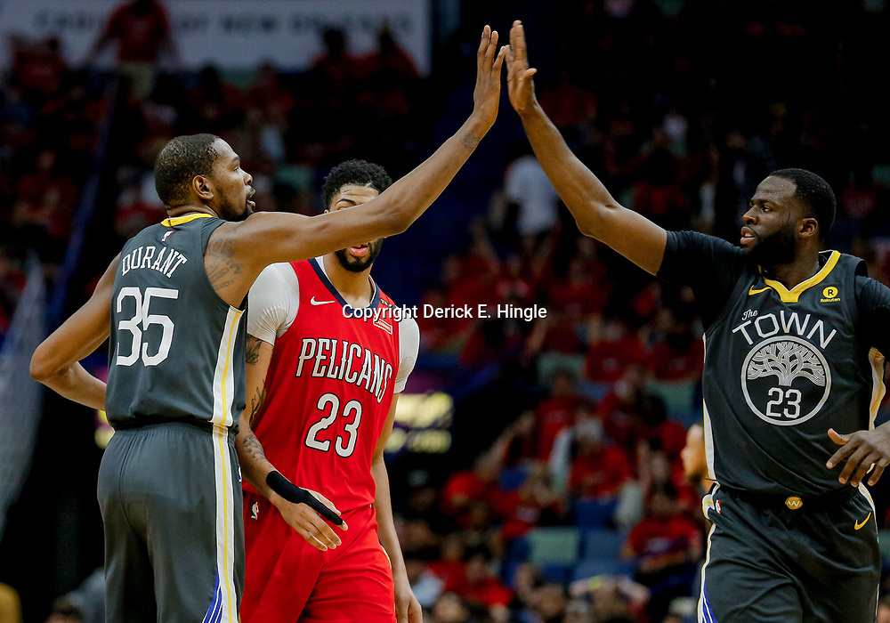 May 6, 2018; New Orleans, LA, USA; Golden State Warriors forward Kevin Durant (35) and forward Draymond Green (23) high five each other during the fourth quarter in game four of the second round of the 2018 NBA Playoffs against the New Orleans Pelicans at the Smoothie King Center. The Warriors defeated the Pelicans 118-92. Mandatory Credit: Derick E. Hingle-USA TODAY Sports