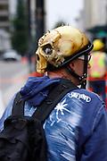 Biker wearing a skull helmet.