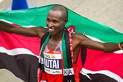 ING New York CIty Marathon: winner Geoffrey Mutai drap[ed in flag of Kenya