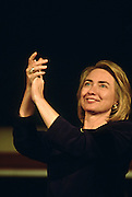 U.S. First lady Hillary Clinton applauds during a campaign stop on the presidential re-election bus tour August 30, 1996 in Cape Girardeau, MO.