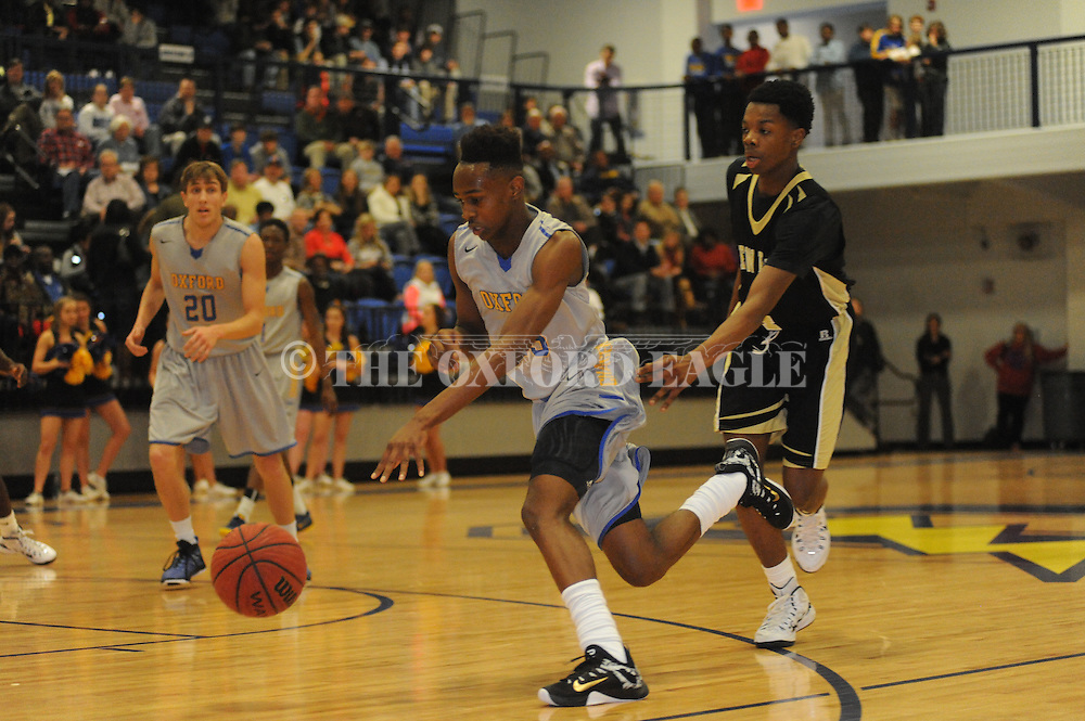 Oxford High's Cortez Jones (15) dribbles against New Hope's Demyis Mayberry (4) in Oxford, Miss. on Friday, February 6, 2015.