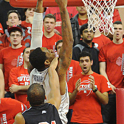 Rutgers Scarlet Knights forward/center Austin Johnson (21) fouls Connecticut Huskies forward/center Alex Oriakhi (34) during Rutgers' 67-60 upset victory over #8 UConn in NCAA Big East Basketball action at the Louis Brown Athletic Center in Piscataway, N.J. on Jan 7, 2012.