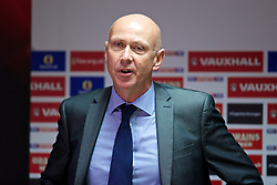 CARDIFF, WALES - Thursday, October 9, 2014: Wales' head of pubic affairs Ian Gwyn Hughes during a press conference at the Cardiff City Stadium ahead of the UEFA Euro 2016 qualifying match against Bosnia and Herzegovina. (Pic by David Rawcliffe/Propaganda)