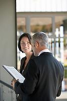 Businessman talking to businesswoman.