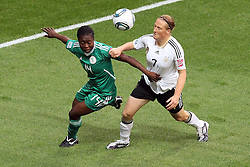 30.06.2011, Commerzbank Arena, Frankfurt, GER, FIFA Women Worldcup 2011, Gruppe A, Deutschland (GER) vs. Nigeria (NGA), im Bild:  Faith Ikidi (Nigeria #14) (L) gegen Melanie Behringer (GER #07, Frankfurt) (R)..// during the FIFA Women Worldcup 2011, Pool A, Germany vs Nigeria on 2011/06/30, Commerzbank Arena, Frankfurt, Germany.  EXPA Pictures © 2011, PhotoCredit: EXPA/ nph/  Mueller *** Local Caption ***       ****** out of GER / CRO  / BEL ******