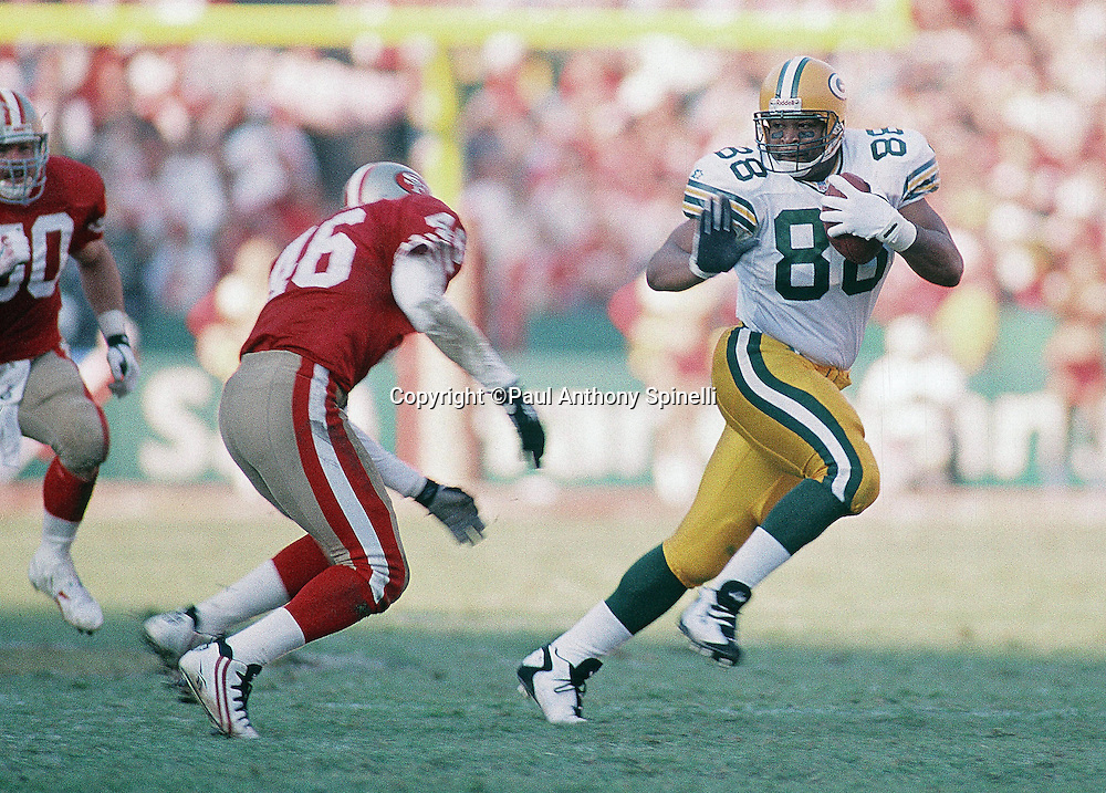 Green Bay Packers tight end Keith Jackson (88) looks to straight arm a defender after catching a pass during the NFL NFC Divisional Playoff football game against the San Francisco 49ers on Jan. 6, 1996 in San Francisco. The Packers won the game 27-17. (©Paul Anthony Spinelli)