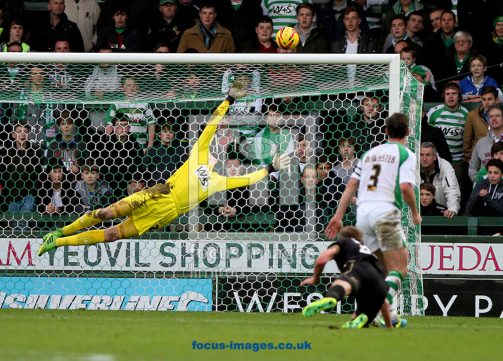 Picture by Tom Smith/Focus Images Ltd 07545141164<br /> 10/11/2013<br /> Marc Albrighton of Wigan Athletic hits the crossbar with his shot during the Sky Bet Championship match at Huish Park, Yeovil.