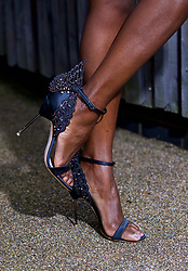 LIVERPOOL, ENGLAND - Thursday, April 6, 2017: Lystra Adams, 40 from Staffordshire, wearing shoes from Sophie Webster, during The Opening Day on Day One of the Aintree Grand National Festival 2017 at Aintree Racecourse. (Pic by David Rawcliffe/Propaganda)