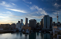 Skyline of the central business district at dawn, Auckland, New Zealand viewed from Princes Wharf.