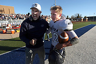 Sabetha coach Garrett Michael hugs Gabe Garber after Garber scored a two-point PAT in overtime to win the 3A state Championship 43-42 over Pratt Saturday, Nov. 24, 2018 in Hutchinson, Kan. [Travis Morisse]