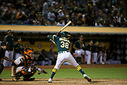 Oakland Athletics center fielder Jaycob Brugman (38) watches for a San Francisco Giants pitch at Oakland Coliseum in Oakland, California, on August 1, 2017. (Stan Olszewski/Special to S.F. Examiner)