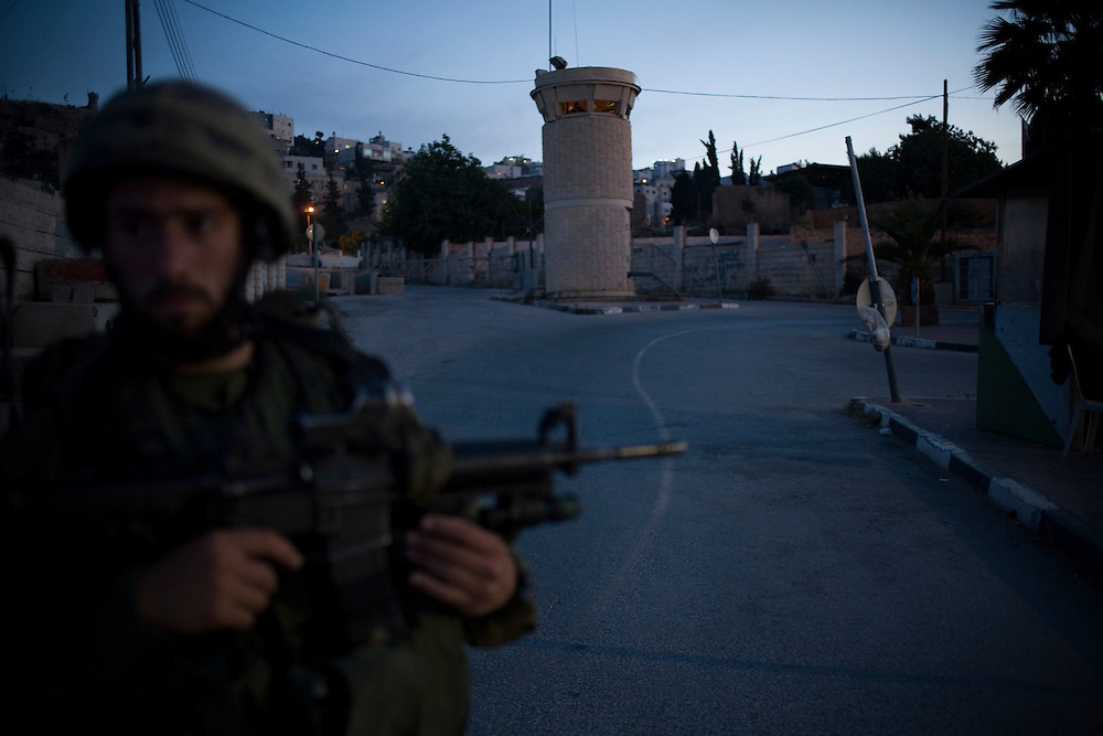 An Israeli soldier stands on duty close to a observation tower in the West Bank town of Hebron on Tuesday 20th May 2008