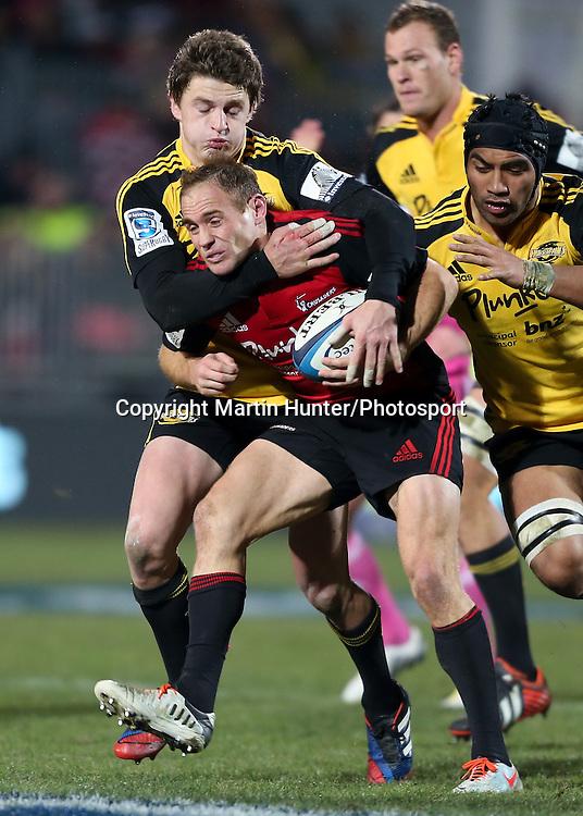 Andy Ellis & Beauden Barrett. Crusaders vs.Hurricanes. Investec Super 15 Rugby Season. AMI Stadium, Christchurch, New Zealand. Friday 12 July 2013. Photo: Martin Hunter/Photosport.co.nz