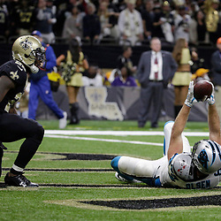 Jan 7, 2018; New Orleans, LA, USA; Carolina Panthers tight end Greg Olsen (88) celebrates after catching a pass for a touchdown against New Orleans Saints defensive back Rafael Bush (25) during the fourth quarter in the NFC Wild Card playoff football game at Mercedes-Benz Superdome. Mandatory Credit: Derick E. Hingle-USA TODAY Sports