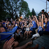 March 31, 2012 - Lexington, Kentucky, USA - While watching a television on a front porch, University of Kentucky basketball fans celebrate their team's victory over the University of Louisville in Lexington, Ky., on March 31, 2012. The win for Kentucky advances them to the championship game of the NCAA tournament in New Orleans. (Credit image: © David Stephenson/ZUMA Press)
