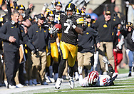 October 31, 2009: Iowa wide receiver Marvin McNutt (7) on a 92 yd touchdown reception during the second half of the Iowa Hawkeyes' 42-24 win over the Indiana Hoosiers at Kinnick Stadium in Iowa City, Iowa on October 31, 2009.