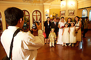 Wedding party at Continental Hotel. Official souvenir photo.