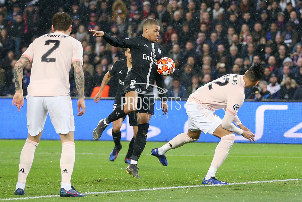 Kylian Mbappe of Paris Saint-Germain attacks the goal against Manchester United Defender Chris Smalling during the Champions League Round of 16 2nd leg match between Paris Saint-Germain and Manchester United at Parc des Princes, Paris, France on 6 March 2019.