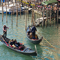 gondoliers are seen carrying passengers on the grand canal in venice