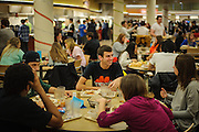 Ohio University student Nick Hart (center) talks with friends in Nelson Dining Hall after finishing dinner on Sunday, December 2, 2012.  (© Brien Vincent)