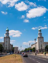 View of Frankfurter Tor historic landmark with TV Tower to rear on Karl Marx Allee in former East Berlin Germany