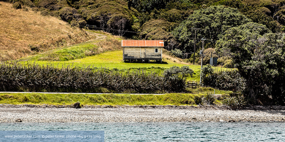 Derelict wooden building, northern coast, Coromandel Peninsula, Hauraki Gulf, New Zealand.