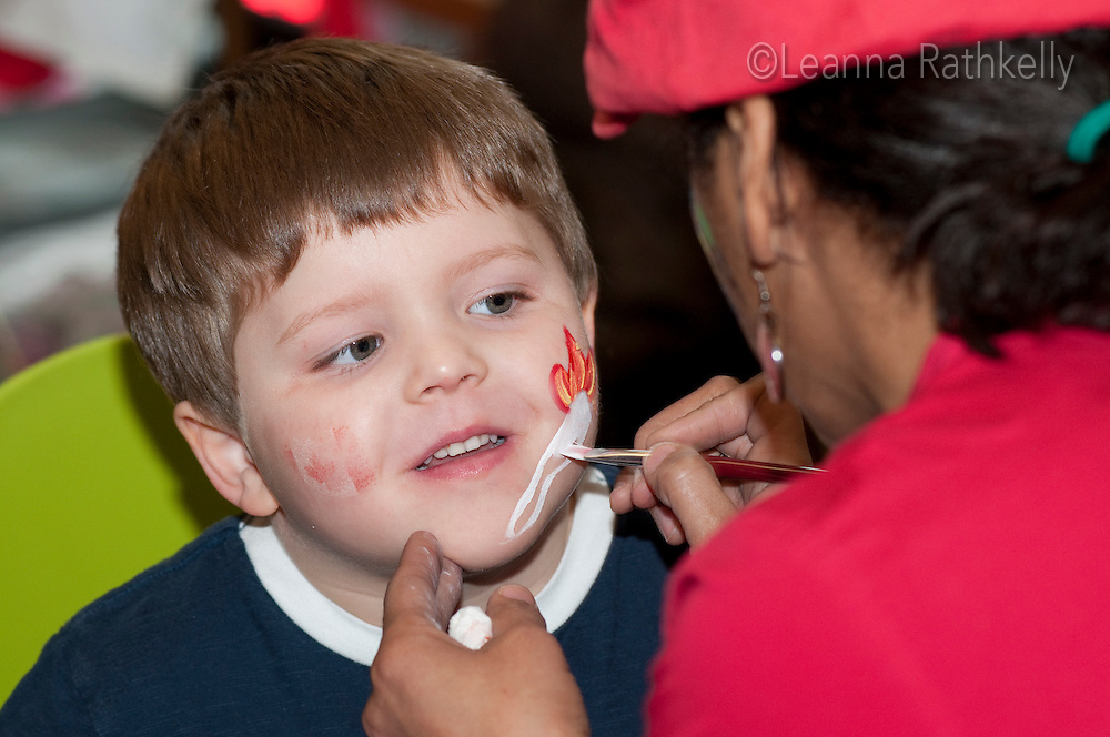 Face painting at Canada House in Whistler is part of the Pancake Breakfasts welcoming the community during the 2010 Olympic Winter Games.