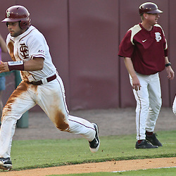 June 03, 2011; Tallahassee, FL, USA; Florida State Seminoles Rafael Lopez (left) and James Ramsey run home during the fifth inning of the Tallahassee regional of the 2011 NCAA baseball tournament against the Bethune-Cookman Wildcats at Dick Howser Stadium. Mandatory Credit: Derick E. Hingle