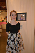 Carnegie Vanguard junior Zoe Herring in front of the display framework she designed and built at Archway Gallery.