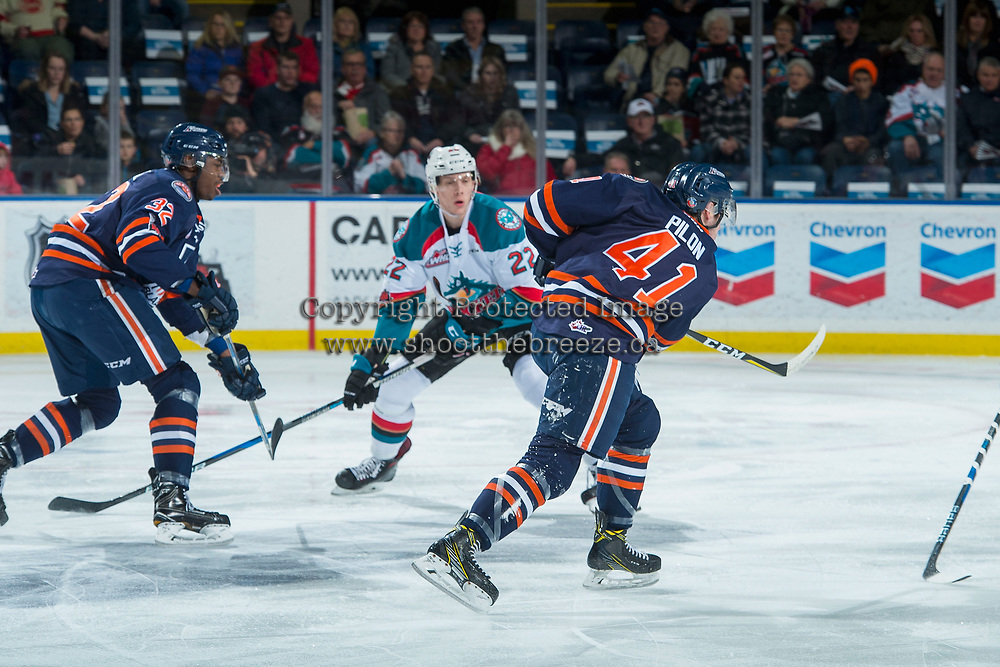 KELOWNA, CANADA - DECEMBER 27: Braydyn Chizen #22 of the Kelowna Rockets skates backward as Garrett Pilon #41 of the Kamloops Blazers takes a shot on net during first period on December 27, 2017 at Prospera Place in Kelowna, British Columbia, Canada.  (Photo by Marissa Baecker/Shoot the Breeze)  *** Local Caption ***