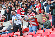 A Sunderland fan dances with the match ball during the EFL Sky Bet Championship match between Sunderland and Burton Albion at the Stadium Of Light, Sunderland, England on 21 April 2018. Picture by John Potts.