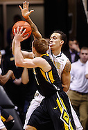 WEST LAFAYETTE, IN - JANUARY 27: Anthony Johnson #1 of the Purdue Boilermakers defends as Mike Gesell #10 of the Iowa Hawkeyes looks to shoot at Mackey Arena on January 27, 2013 in West Lafayette, Indiana. Purdue defeated Iowa 65-62 in overtime. (Photo by Michael Hickey/Getty Images) *** Local Caption *** Anthony Johnson; Mike Gesell