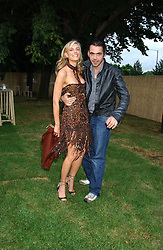 KIM HERSOV and fashion designer ROLAND MOURET at the annual Serpentine Gallery Summer Party co-hosted by Jimmy Choo shoes held at the Serpentine Gallery, Kensington Gardens, London on 30th June 2005.<br />