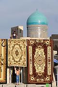 Uzbekistan, Bukhara.<br /> Carpets in front of the mosque at Mir-i-Arab Medressa.