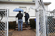 Bernie Sanders volunteers wait for someone to answer the door while canvassing in Springfield, MA, Monday, Feb. 29, 2016.  CREDIT: Cheryl Senter for The New York Times