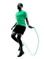 one man exercising jumping rope  fitness  in silhouette isolated on white background