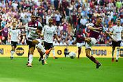 Fulham defender Ryan Fredericks (2)  clears his lines under pressure from Aston Villa midfielder Conor Hourihane (14) during the EFL Sky Bet Championship play-off final match between Fulham and Aston Villa at Wembley Stadium, London, England on 26 May 2018. Picture by Dennis Goodwin.