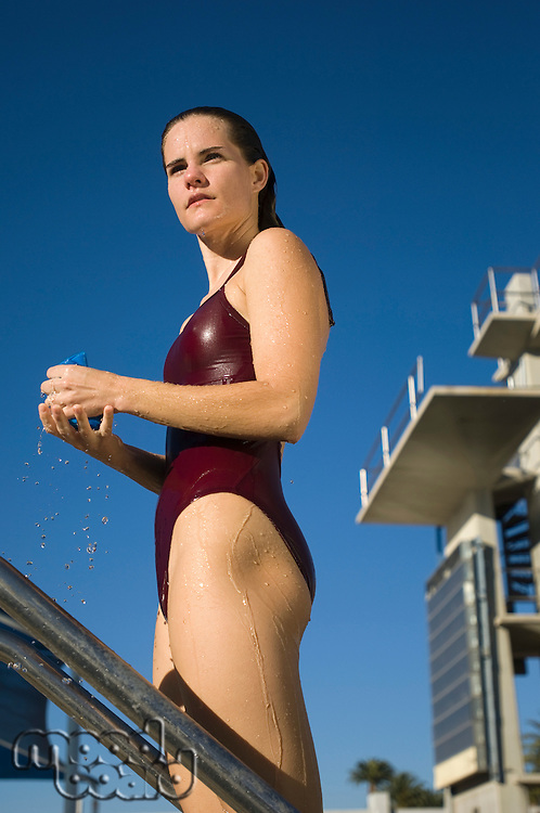 Female swimmer squeezing bathing cap