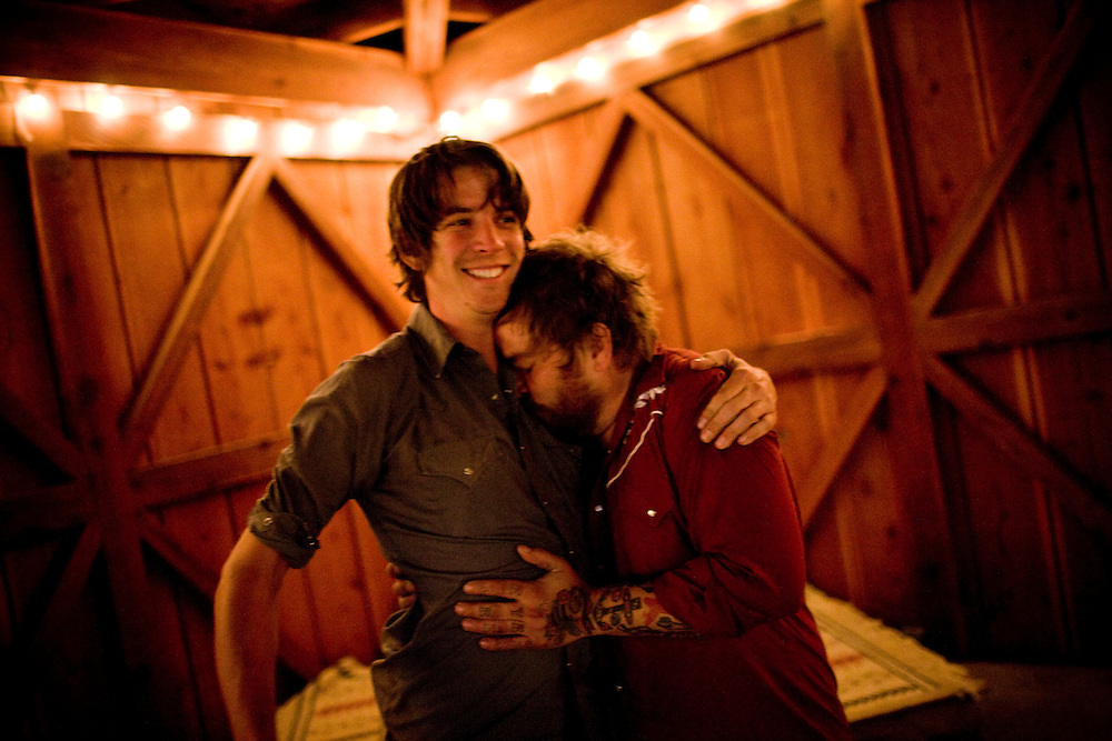 Blind Pilot drummer Ryan Dobrowski, left and vibes player Ian Krist embrace at the Peg House after the show and a long day riding on Highway 101 in Leggett, CA on September 18, 2008.