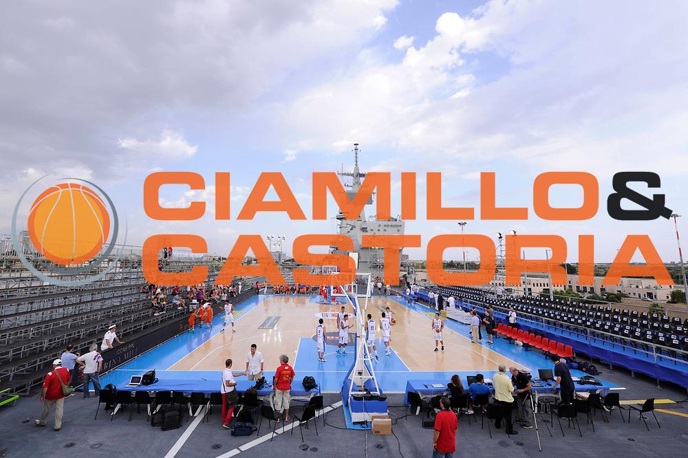 DESCRIZIONE : Taranto Basket On Board sulla portaerei Cavour  Nazionale Italia Under 18 Maschile Svezia <br /> GIOCATORE : panoramica<br /> CATEGORIA : <br /> SQUADRA : Nazionale Italia Under 18<br /> EVENTO :  Basket On Board sulla portaerei Cavour<br /> GARA : Nazionale Italia Under 18 Maschile Svezia <br /> DATA : 12/07/2012 <br />  SPORT : Pallacanestro<br />  AUTORE : Agenzia Ciamillo-Castoria/C. De Massis<br />  Galleria : FIP Nazionali 2012<br />  Fotonotizia : Taranto Basket On Board sulla portaerei Cavour  Nazionale Italia Under 18 Maschile Svezia <br />  Predefinita :