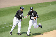 CHICAGO - JUNE 08:  Third base coach Jeff Cox #8 congratulates Paul Konerko #14 of the Chicago White Sox after Konerko hit a home run against the Detroit Tigers on June 8, 2009 at U.S. Cellular Field in Chicago, Illinois.  The Tigers defeated the White Sox 5-4.  (Photo by Ron Vesely)