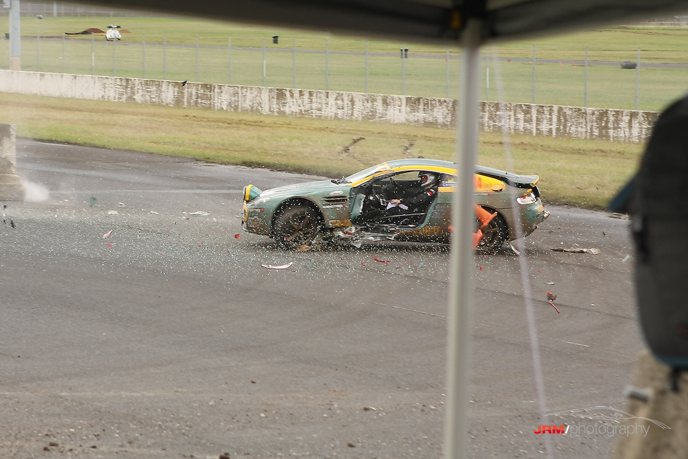 Aston Martin V8 Vantage, crashes backward into the barriers after losing control on the grass at the ARC Calder Rally, Melbourne, Australia.