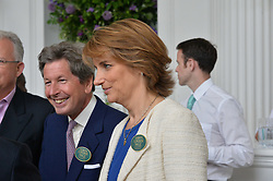 JOHN WARREN HM The Queen's Racing Manager and his wife LADY CAROLYN WARREN at Goffs London Sale held at The Orangery, Kensington Palace, London on 15th June 2015.