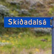 A sign for the river Skíðadalsá, North Iceland.