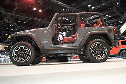 08  February 2013: 2013 Jeep Wrangler Rubicon. Chicago Auto Show, Chicago Automobile Trade Association (CATA), McCormick Place, Chicago Illinois<br /> <br /> 2013 JEEP WRANGLER: Built on more than 70 years of legendary heritage, Jeep is the authentic SUV with class-leading capability and craftsmanship, manufactured in Toledo, OH. The 2013 Wrangler, which was introduced in 1987, is endow with legendary four-wheel drive, body-on-frame design, and one of the few mid-size SUVs that offers a six-speed manual gearbox - in addition to its new five-speed automatic. Available in Sport, Sahara and Rubicon trim levels, the Wrangler two-door body wears Jeep's signature round headlights, seven-slot grille, removable doors and fold-down windshield. For 2013, a new Moab special-edition based on the Sahara model offers added level of off-road capability and celebrates the historic Jeep off-roading destination of Moab, Utah. A new award-winning 3.6 liter (220 cu. in.) V-6 engine provides efficiency up to 21 miles per gallon, while delivering 285 horsepower. Also, Wrangler offers towing capability up to 3,500 lbs. New wheel designs distinguish Wrangler Sahara 18-inch hubs from the aggressive 17-in standard on the Rubicon models. Jeep Wrangler offers many options for top configurations from soft to body-color three-piece hard tops. New for 2013 is a revised soft top on Unlimited models that is easier to raise and lower by one person. The Jeep Wrangler now contains new seats that have been re-contoured and feature larger bolsters; an auto-dimming mirror with LED map lighting, new interior lighting, available Alpine speakers and a premium tire pressure monitoring system.