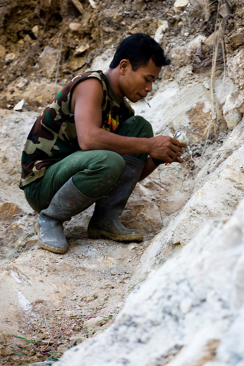 Indonesian military use explosives to clear rocks on the site of the future Trans Papuan Highway near the village of Beniek, Indonesia, Sept. 4, 2008..Daniel Beltra/Greenpeace