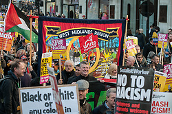 November 17, 2018 - London, United Kingdom - Protesters are seen holding placards and banners during the protest..Huge crowds seen marching from BBC in Portland Place to Whitehall with flags and placards during the National Unity Demonstration to oppose the rise of fascist and racist activity in Europe, The demonstration was called Unite against Fascism, Love Music Hate Racism and Stand up to racism while the speeches at the Whitehall were disrupted by the presence of a small number of far right activists and Trump supporters. (Credit Image: © Andres Pantoja/SOPA Images via ZUMA Wire)