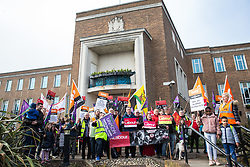 Maidenhead, UK. 23rd February, 2019. Matt Rodda, Labour MP for Reading East, joins members of the Windsor and Maidenhead branches of the Labour Party and UNISON and GMB trade unions at a protest outside Maidenhead Town Hall in Prime Minister Theresa May's constituency against planned spending cuts of £6.8m to the 2019/2020 budget by the Royal Borough of Windsor and Maidenhead. Over 1,000 people had signed a petition to the council demanding an alternative to the cuts.